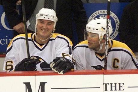 Jaromir Jagr (right) broke in with superstar Mario Lemieux, and they won two Cups together with the Penguins.